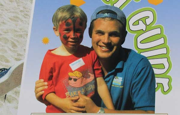 Happy staff and children on the Barracudas Activity Camp brochure