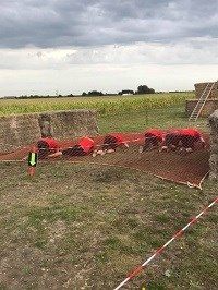 Barracudas team under the netting at Insane Terrain